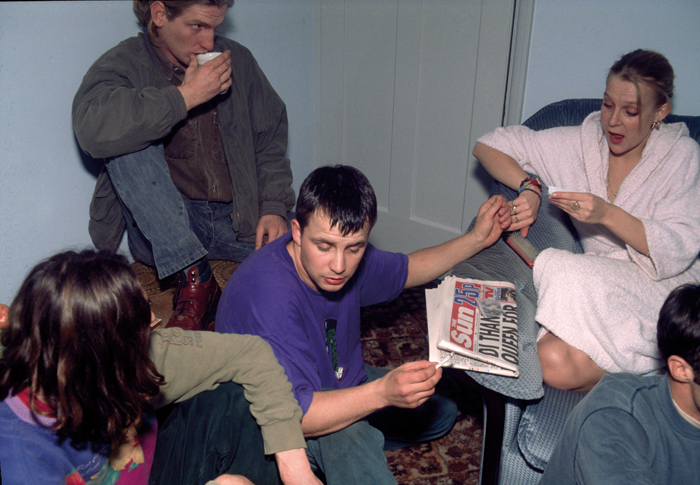 Off duty paratroopers after a rave in a living room, smoking weed, 1992