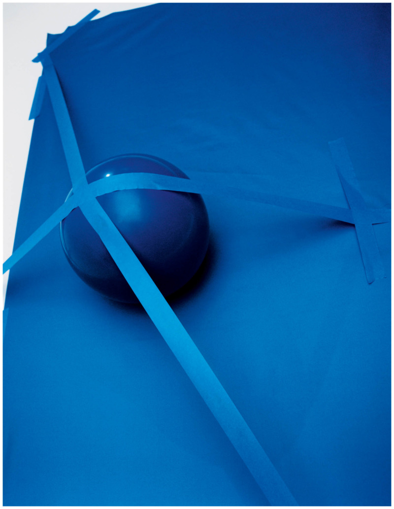a blue ball tied down with blue straps to a blue surface