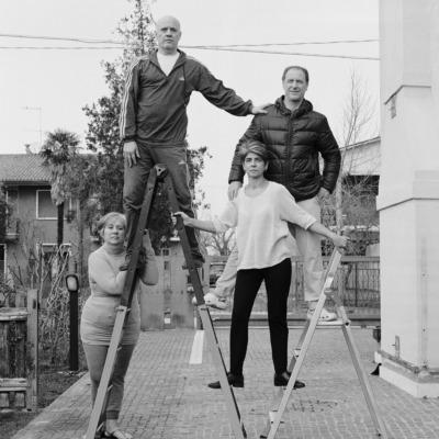 The Agostini family climb a set of ladders.