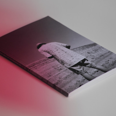 black and white cover showing a person from behind, tilting his head in front of a landscape, of paper journal best of instagram vol. 1