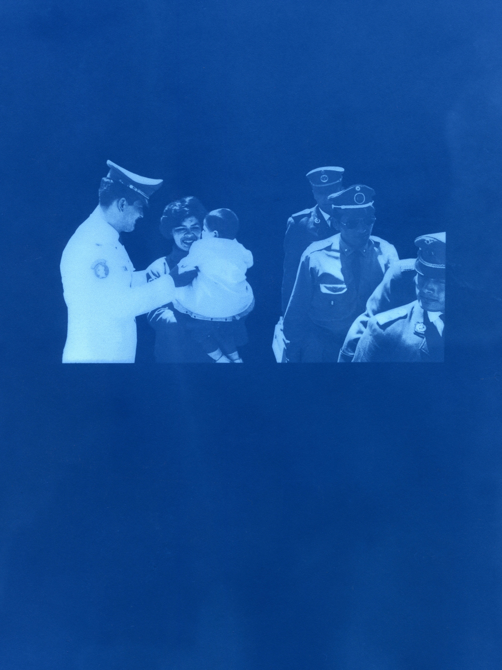 A cyanotype copy of another photograph. A mother holds a baby while military men walk past her.